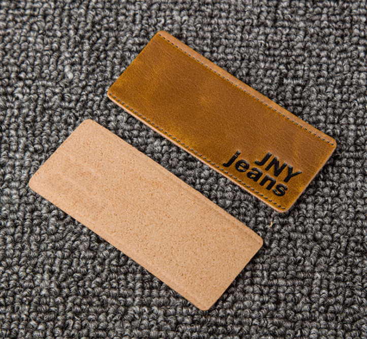 Embossed leather tag for cloth